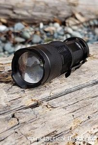 Tactical flashlight. Embrace your inner geek with these amazing inexpensive bulk promotional products. Get your logo or corporate brand on these factory direct promotional products and trade show swag.
